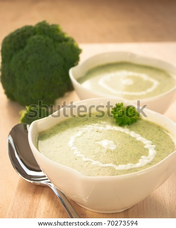 Rich vegetable broccoli soup with cream garnish - stock photo