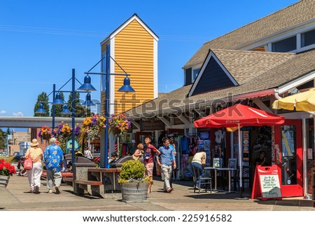 RICHMOND, BC, CANADA - JULY 08, 2014: Unidentified people enjoying sunny day in Steveston Village in Richmond. Steveston is a historic fishing village. It has become a popular place to visit and live. - stock photo