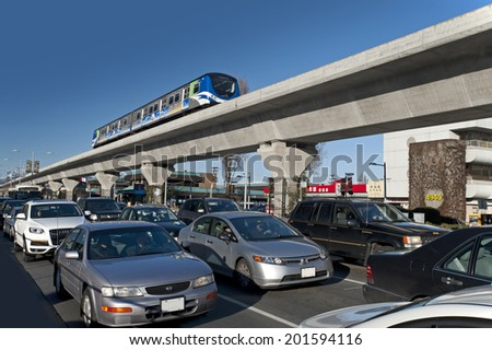 RICHMOND, BC - FEB. 19, 2011: SkyTrain, fully automatic transit system of Metro Vancouver has 69 km of track and 47 stations on 3 lines. Expo Line open 1985, Millennium Line 2002 and Canada Line 2009. - stock photo