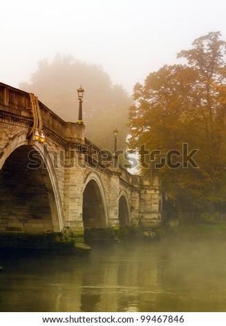 Richmond Bridge in Autumn with mist - stock photo