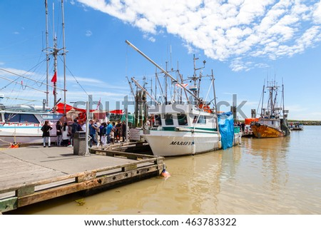 RICHMOND, CANADA - JULY 10: Visitors at the seaside village of Steveston Fisherman's Wharf in Richmond near Vancouver July 10, 2016. The place  offers fresh seafood, many eateries and unique shops.