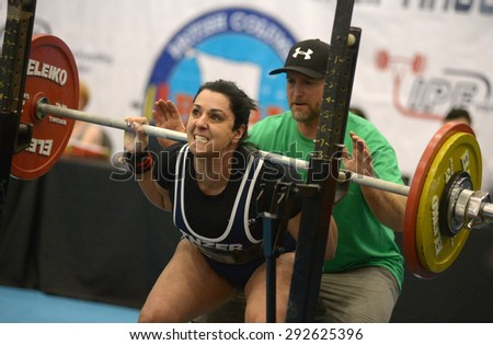 RICHMOND, CANADA - MARCH 20, 2013: Athletes compete at a local Powerlifting Tournament in Richmond, BC, Canada, March 20, 2013. - stock photo
