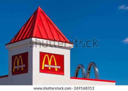 RICHMOND HILL - APR 11: McDonalds sign and arches on a small building with white walls and a red cupola, photographed on April 11, 2015.  - stock photo
