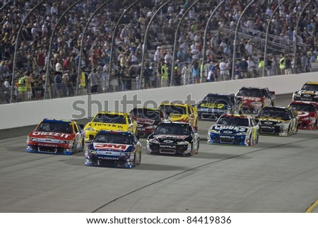 Richmond, VA - SEP 10, 2011: Greg Biffle (16) and Carl Edwards (99) race for the Wonderful Pistachios 400 race at the Richmond International Raceway in Richmond, VA on Sep 10, 2011 - stock photo