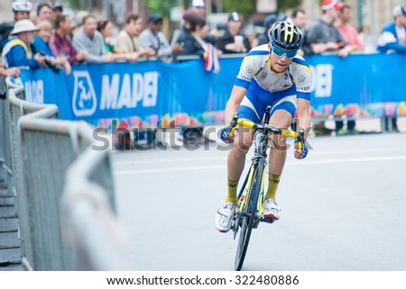 RICHMOND, VIRGINIA - SEPTEMBER 26: A cyclist competes in the junior men's road race at the UCI Road World Championships on September 26, 2015 in Richmond, Virginia   - stock photo
