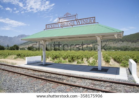 RICKETY BRIDGE RAIL LINE AT FRANSCHHOEK WESTERN CAPE SOUTH AFRICA - CIRCA 2014 - Rickety Bridge Winery railway station for tourist tram ride between vineyards in the Franschhoek Valley Southern Africa