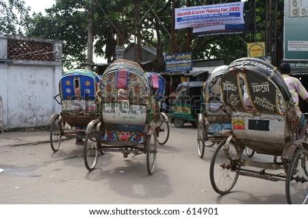 Rickshaws in Bangladeshi capital of Dhaka - stock photo
