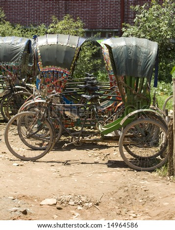 Rickshaws parked for the day, Bangladesh has an estimated 170,000 active rickshaws on the roads today. - stock photo