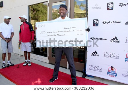 Ricky Smith and a check from the Will and Jada Smith Foundation at the inaugural Stephen Bishop celebrity golf invitational benefiting R.A.K.E.,  Feb. 15, 2016 , Calabasas Country Club, Calabasas, CA. - stock photo