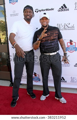 Ricky Smith and D.L. Hughley arrive at the inaugural Stephen Bishop celebrity golf invitational benefiting R.A.K.E. on Feb. 15, 2016 at Calabasas Country Club in Calabasas, CA. - stock photo