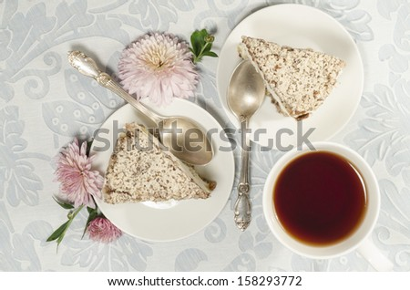 """Ricotta and Pear Cake with cup of tea and bouquet of chrysanthemums. From the series """"Italian desserts"""" - stock photo"""