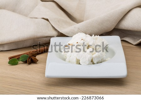 Ricotta cheese with cinnamon and mint leaves