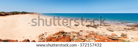Riddell Beach is located between Riddell Point and Gantheaume Point, only about 8 km out of town. It's a scenic area of red pindan cliffs contrasted against the Indian Ocean.  - stock photo
