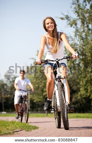 ride a bike on the summer park - stock photo