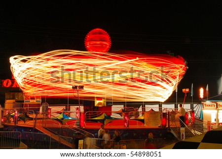 Ride at the county fair at night in Roseburg Oregon - stock photo