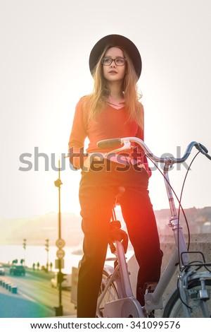 Ride on a white bike - stock photo