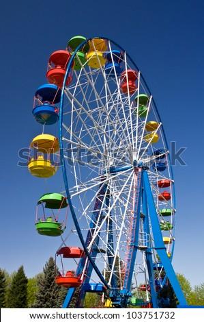 Ride on Ferris wheel in Amusement Park - stock photo