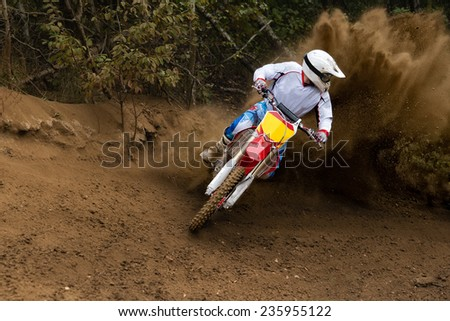 Rider driving in the motocross race - stock photo