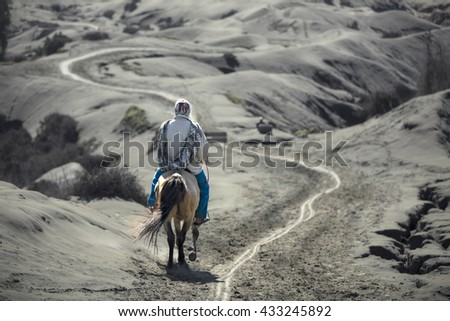 Rider for tourists at Mount Bromo in Java , Indonesia. - stock photo