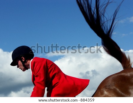 Rider going over a Jump - stock photo