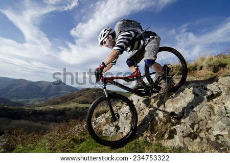 Rider in action at Freestyle Mountain Bike Session - stock photo