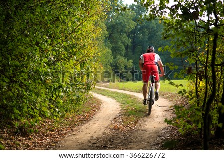 Rider on Mountain Bicycle it the forest - stock photo