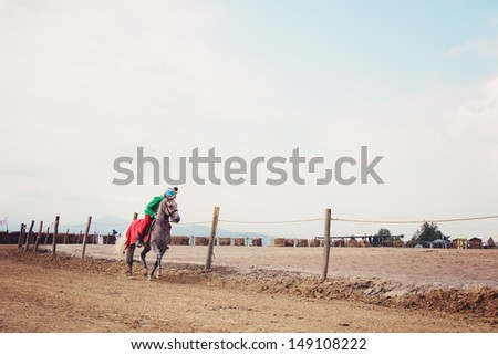 Rider warming up his horse - stock photo