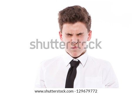 ridiculous boy inflates cheeks on the isolated background - stock photo