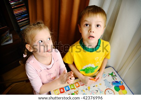 Ridiculous children play together - stock photo