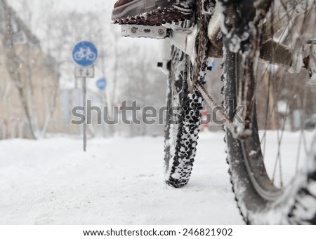 Riding a bicycle in Winter over snow - stock photo