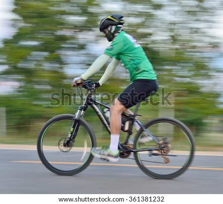 Riding a bike on a street  motion blur  - stock photo