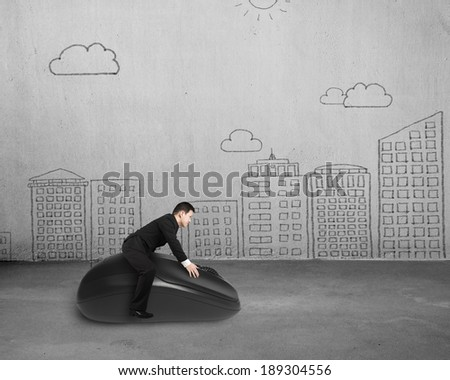 Riding computer mouse with cityscape doodles on wall - stock photo