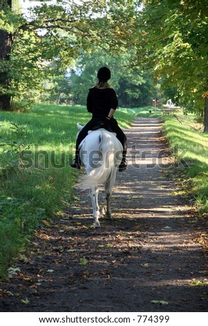 Riding down the path - stock photo