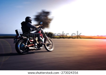 Riding motorcycle pan technic used. - stock photo