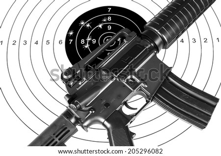 Rifle and shooting target - stock photo