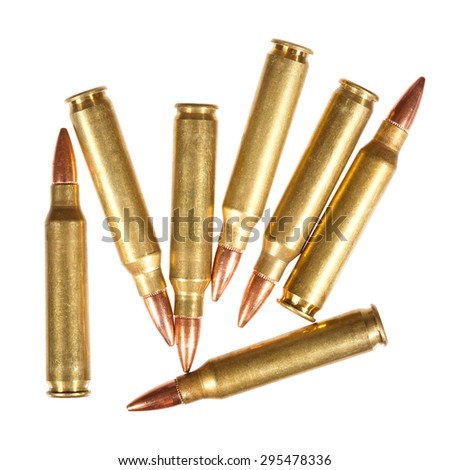 Rifle bullets on a white background. - stock photo