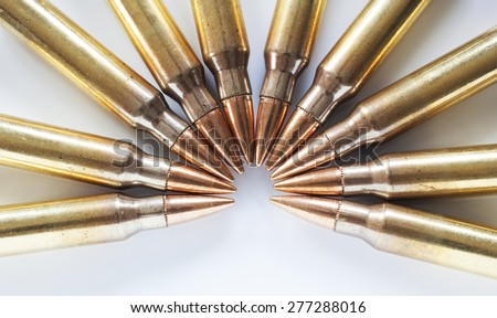 Rifle cartridges with a steel core considered armor piercing on a white background - stock photo