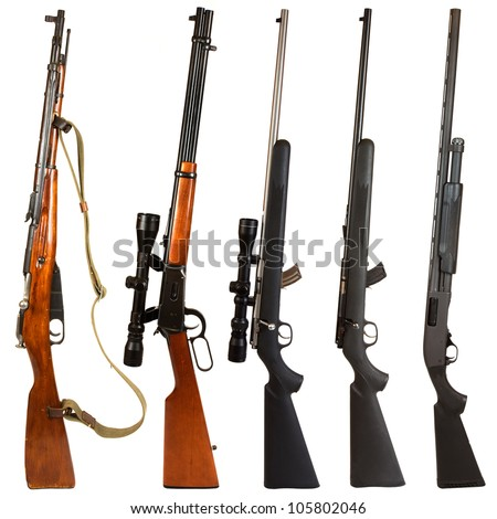 Rifles isolated on white background depicting a Russian Mosin Nagant, 30-30 Winchester rifle, 22. rifle with scope, 22.  rifle without a scope, and a black pump-action 12 gauge shotgun. - stock photo