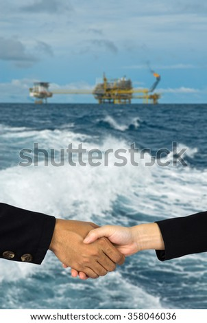 rig background with man and woman shakehands