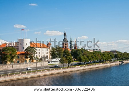 Riga castle, dome Cathedral, the Church of St. Peter and the Anglican Church on the Daugava river embankment - stock photo