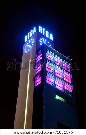 Riga central station clock tower - stock photo