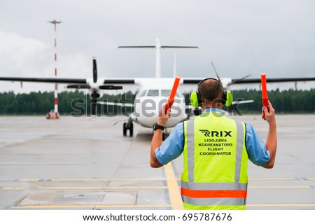 flight coordinator guiding airplane parking spot stock photo 695787331 shutterstock. Black Bedroom Furniture Sets. Home Design Ideas