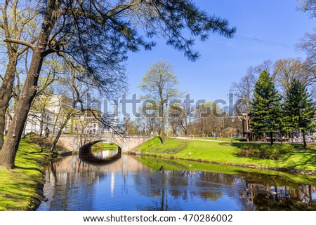Riga, Latvia - April 29, 2016: Bastejkalna parks (Bastion Hill park) in Riga a park for romantics with narrow paths lined with trees or the canal so still it resembles glass.