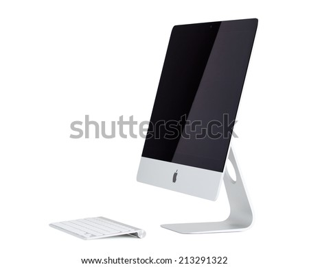 RIGA, LATVIA - AUGUST 4, 2014: Photo of the latest generation iMac with 21.5 in screen. The iMac is a range of all-in-one Macintosh desktop computers designed and built by Apple Inc.  - stock photo