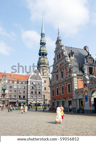 RIGA, LATVIA - AUGUST 8: Tourists Walking Through The Town Hall Square On August 8, 2010 in Riga, Latvia - stock photo