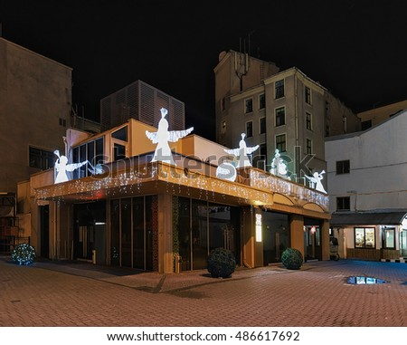 Riga, Latvia - December 25, 2015: Angel statues on the roof of the building at street the Riga Christmas Market in Riga, Latvia.