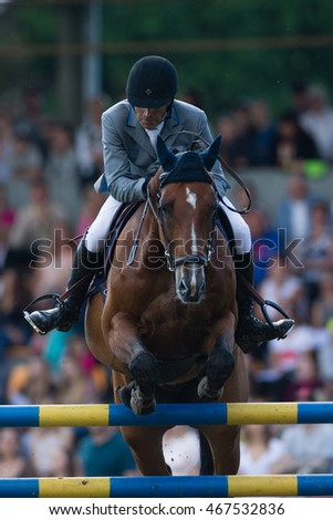 RIGA, LATVIA - JULY 31: Gunnar KLETTENBERG jumps over the obstacle with horse QUOTE, World Cup competition, Grand Prix Riga 2016, CSI2*-W, CSIYH1* on JULY 31, 2016 in Kleisti equestrian sports center