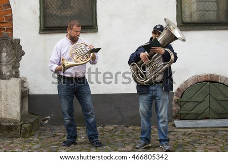 RIGA, LATVIA - July 09, 2016: Street musicians in old Riga city, Latvia, Europe