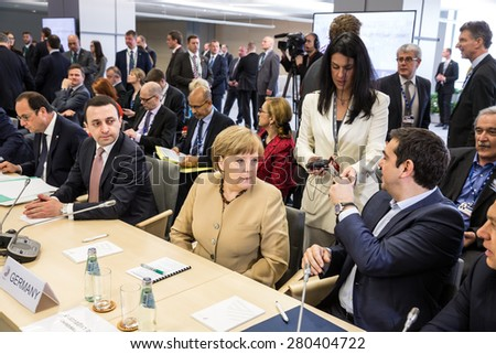 RIGA, LATVIA - May 22, 2015: Eastern Partnership Sammit. Chancellor of the Federal Republic of Germany Angela Merkel and Greek Prime Minister Alexis Tsipras - stock photo