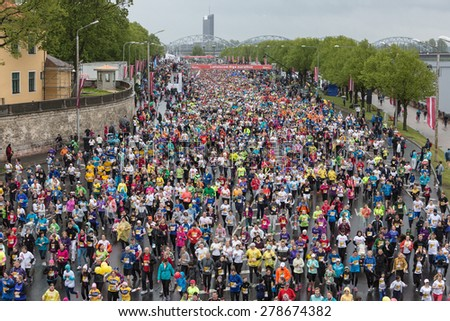 Riga, Latvia - May  17, 2015: Lattelecom Riga Marathon with 25 931participants from 69 countries. 5km participants distance start.